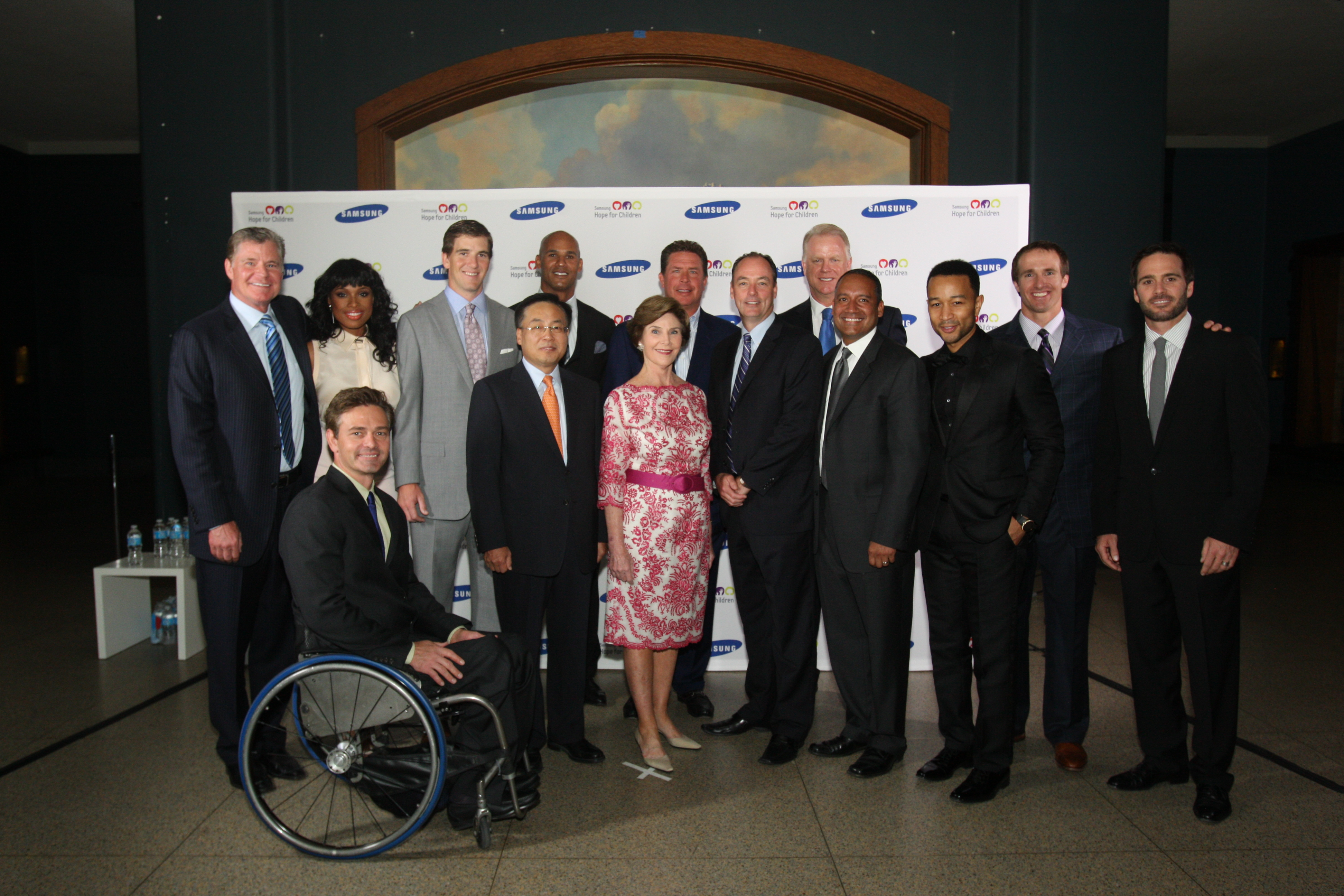 Dan Patrick, Jennifer Hudson, Eli Manning, Jason Taylor, Dan Marino, Boomer Esiason, Drew Brees, Chris Waddell, Samsung President and CEO YK Kim, Laura Bush, Samsung Electronics America's President of Consumer Business Division Tim Baxter, Samsung Electronics America's CMO Ralph Santana, John Legend and Jimmie Johnson at the 2012 Samsung Hope for Children Gala at the American Museum of Natural History in (NYC, 2012)