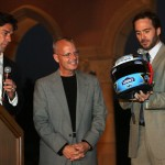Jimmie, Emcee Jason Sehorn and Mike Wells from Blue Bunny admire the 2012 Blu eBunny Helmet of Hope, which Jimmie wore at Sonoma (San Diego, 2012)