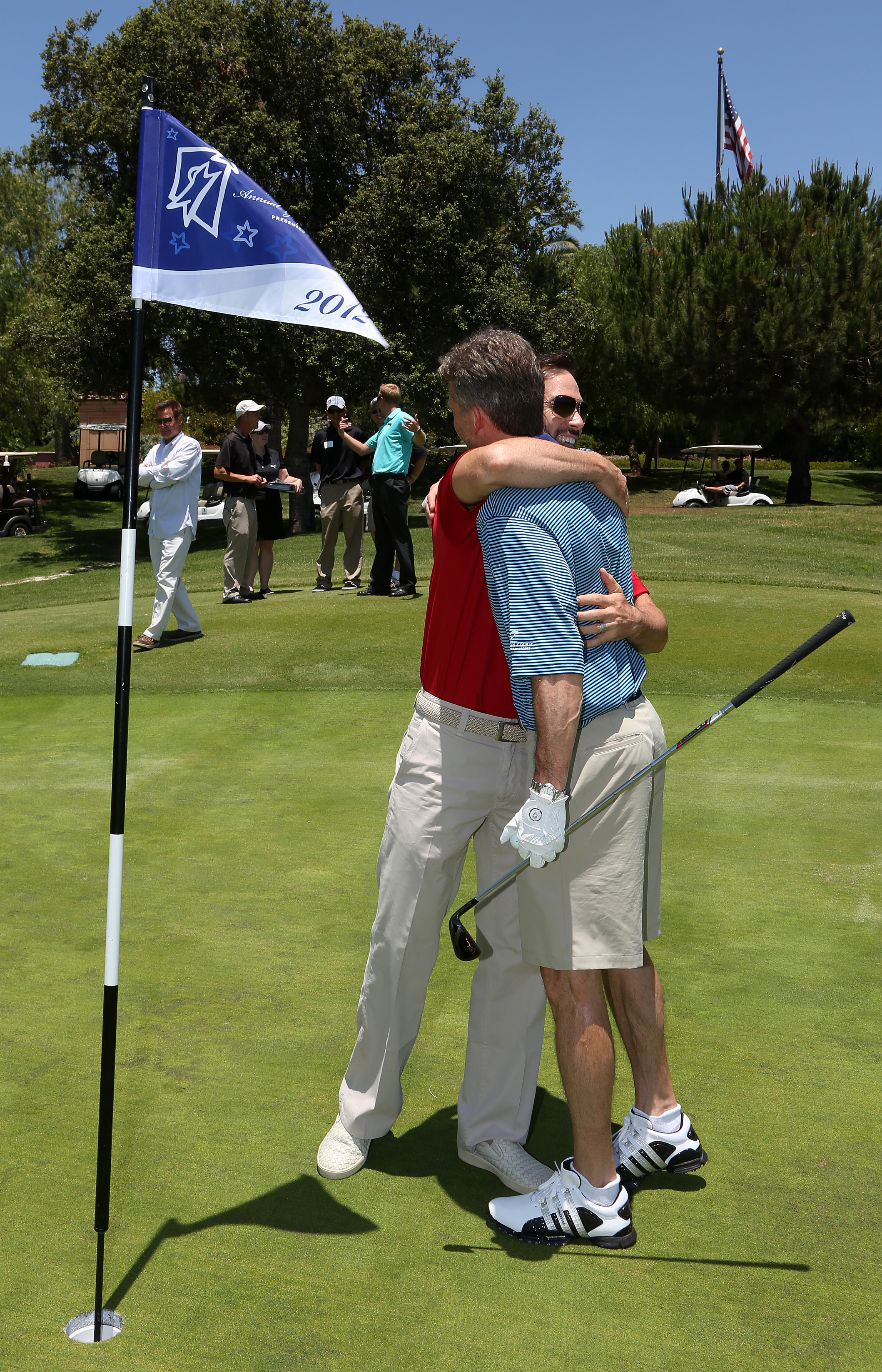 Jimmie congratulates NASCAR CMO Steve Phelps after he got a Hole in One and won a car! (San Diego, 2012)
