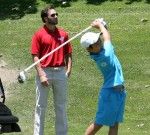 Jimmie watching as Robert You, the youngest participant, tees off (San Diego, 2012)