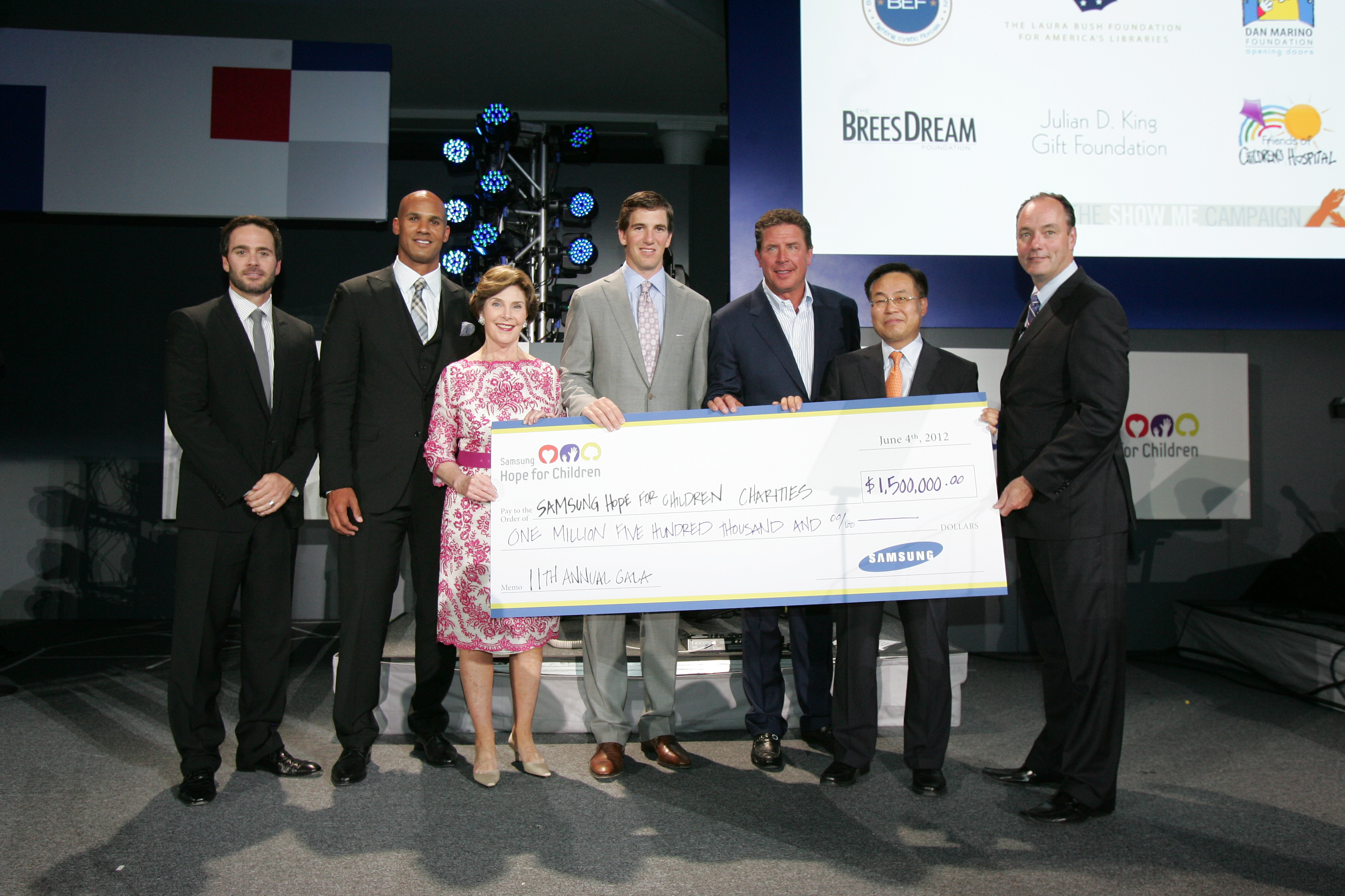 Jimmie and fellow honorees at the 2012 Samsung Hope for Children Gala in New York City.  Pictured left to right are Jimmie, Jason Taylor, Laura Bush, Eli Manning, Dan Marino, Samsung President and CEO YK Kim, Samsung Electronics America's President of Consumer Business Division Tim Baxter (NYC, 2012)