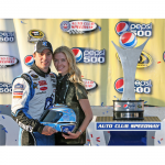 Random image: Jimmie and Chandra celebrate with the Helmet of Hope in Victory Lane at the Pepsi 500 (Fontana, 2009).