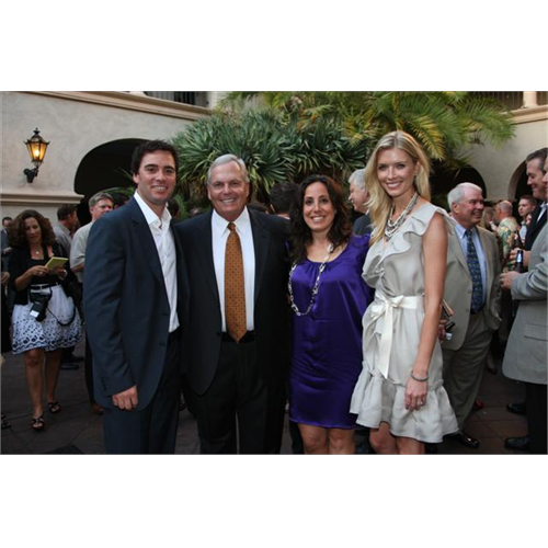 Jimmie and Chandra with Rick Hendrick and Auto Club Speedway President Gillian Zucker at the tournament dinner and auction (San Diego, 2008).
