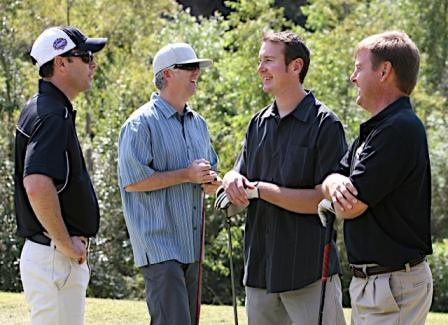 Jimmie chats with Sprint's Jeff Smith, fellow NASCAR driver Kurt Busch and News 8 Sports Anchor John Howard (San Diego, 2009).