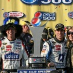 Chad, Jimmie and Chandra celebrate the 3rd win in a row at Auto Club Speedway in victory lane (Fontana, CA - October 11, 2009).