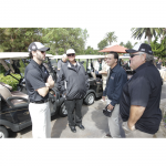 Jimmie talks with father, Gary, and brother, Jessie, at the 2010 Jimmie Johnson Foundation Annual Golf Tournament (San Diego, 2010)