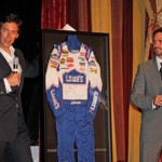 Jason Sehorn, emcee for the evening, auctions a 2010 Championship Fire Suit with Jimmie. (San Diego, 2011)