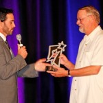 Jimmie surprises his former team owner, Stan Herzog, with the Star of the Year Award in honor of the Herzog's ongoing support of the foundation. (San Diego, 2011).