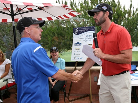 Jimmie thanks Blue Bunny CEO Mike Wells at the post tournament awards reception. (San Diego, 2011)