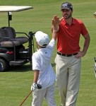 Jimmie gives the youngest golfer a high five. (San Diego, 2011)
