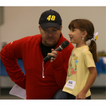 Wilson, the emcee for Foundation Fest: Charlotte, with a young fan (Charlotte, 2012)