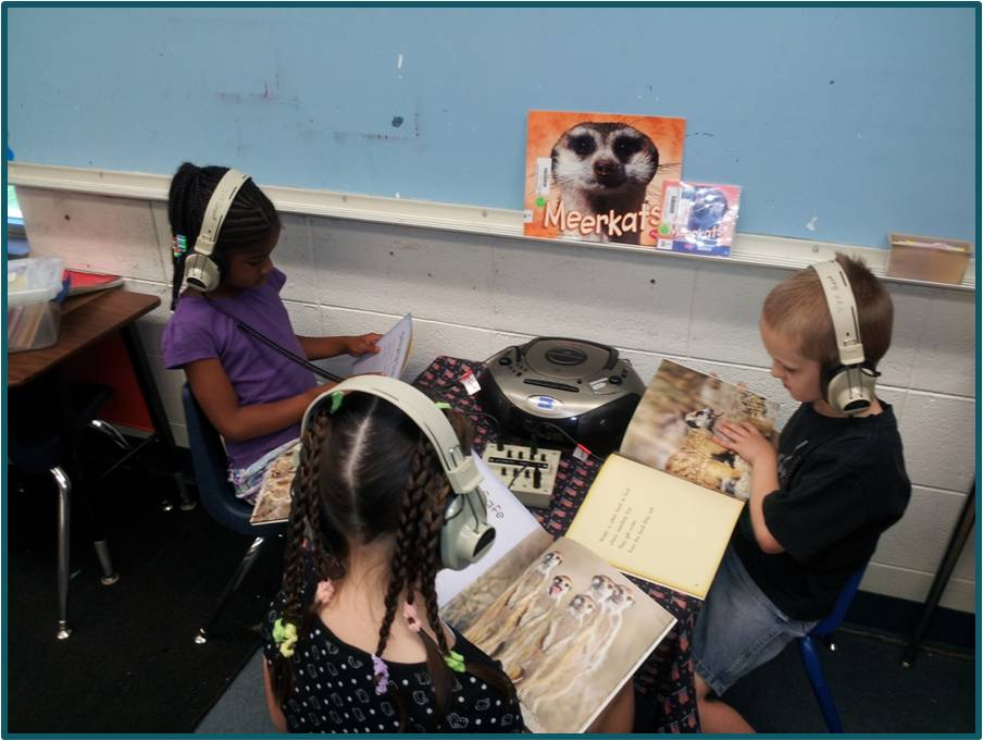 Cherokee first graders using a listening station to learn about Meerkats (Muskogee, 2010)