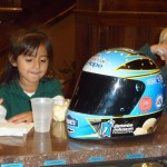 A young participant in the United Way's literacy program enjoying her Blue Bunny ice cream with the Blue Bunny Helmet of Hope (Le Mars, 2012)