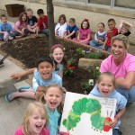 Tony Goetz students reading in their garden (Muskogee, 2009)