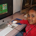 A student at WD Hall Elementary using a new iMac and Imagine Learning software (El Cajon, 2011)